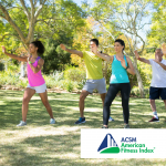 group of people doing tai chi in the park